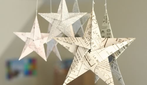 5 pointed origami stars hanging on mirror 500x291