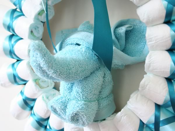 Rolled Diaper Wreath Instructions - Decorated with Washcloth Elephant