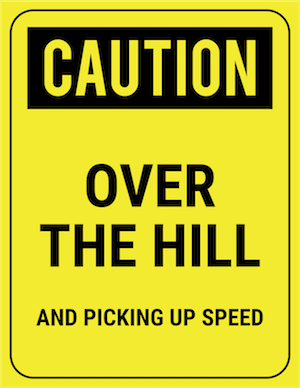 funny safety sign caution over the hill and picking up speed