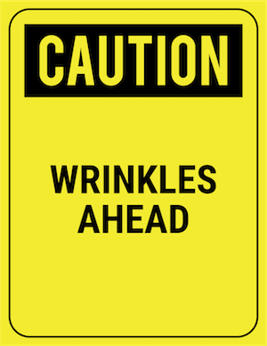 funny safety sign caution wrinkles ahead