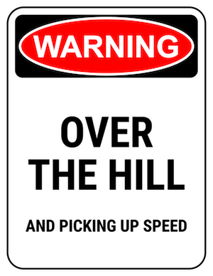 funny safety sign warning over the hill and picking up speed