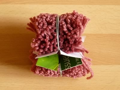 how to make pom poms step 5b