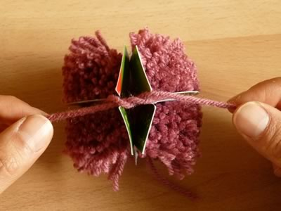 how to make pom poms step 6b