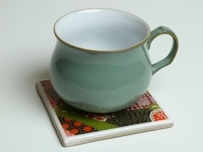 how to make tile coasters - finished with green cup