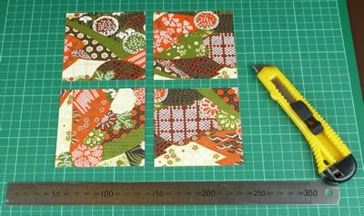 cut out paper squares to decorate tile coasters