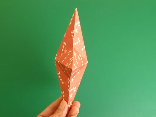 making christmas decorations completed double sided paper star side view