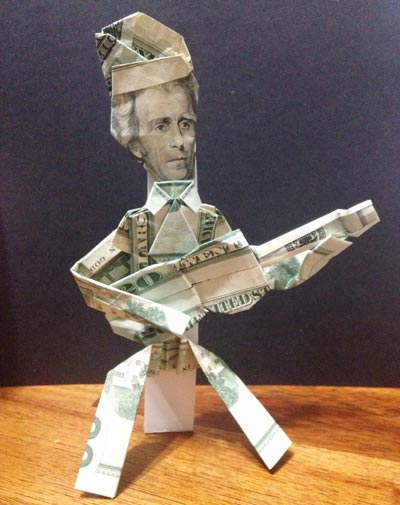 money origami person with guitar