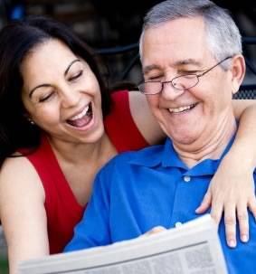 smiling couple looking at generated newspaper