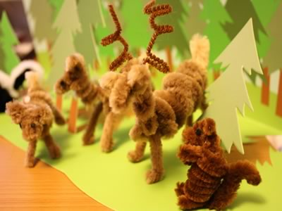 pipe cleaner animals woodland scene with deer and squirrel