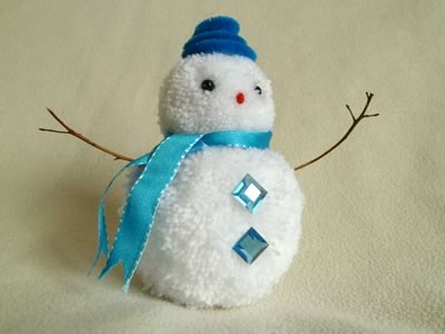 snowman christmas crafts - pom pom snowman in blue hat
