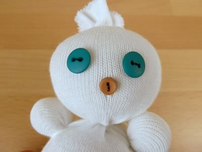 sock snowman - sewing on a face